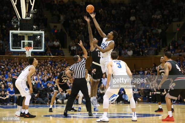 Duke forward Wendall Carter Jr and Louisville forward Ray Spalding reach for the tip off during the game between the Louisville Cardinals and the...