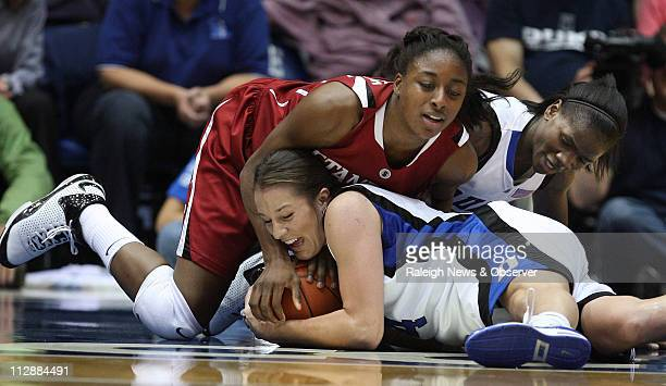Duke guard Abby Waner and teammate Bridgette Mitchell wrestle with Stanford forward Nnemkadi Ogwumike during first half action at Cameron Indoor...