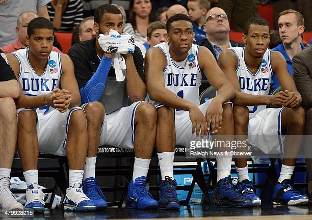 Duke guard Andre Dawkins forward Josh Hairston forward Jabari Parker and forward Rodney Hood sit as time expires as the Blue Devils were upset by...