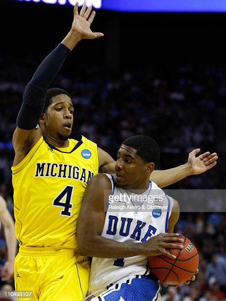 Duke guard Kyrie Irving moves inside against Michigan guard Darius Morris during firsthalf action in the third round of the men's NCAA basketball...