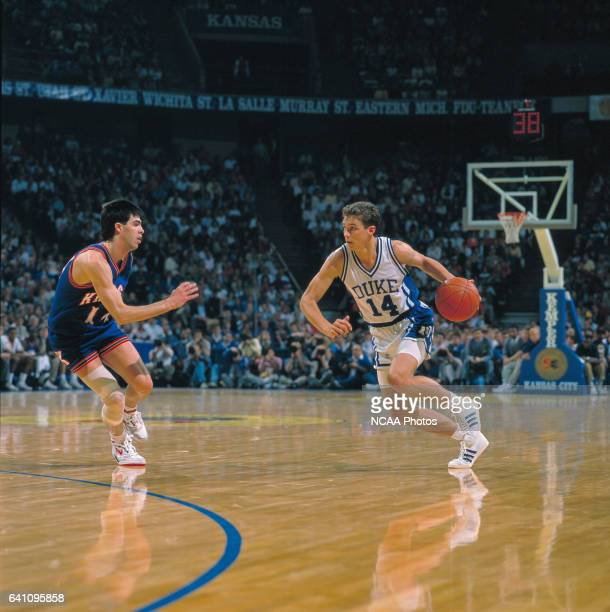 Duke guard Quin Snyder dribbles toward Kansas guard Kevin Pritchard during the NCAA Photos via Getty Imagess via Getty Images Men's National...