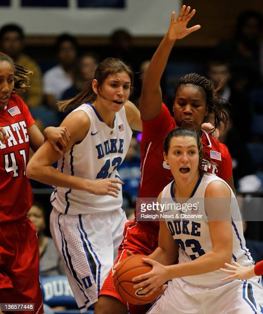 Duke guard/forward Haley Peters looks for help as NC State guard Myisha GoodwinColeman defends Duke beat NC State 8359 at Cameron Indoor Stadium in...