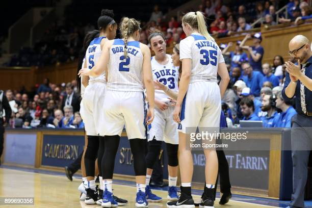 Duke head coach Joanne P McCallie talks to her players including Leaonna Odom Haley Gorecki Rebecca Greenwell and Erin Mathias during a timeout...