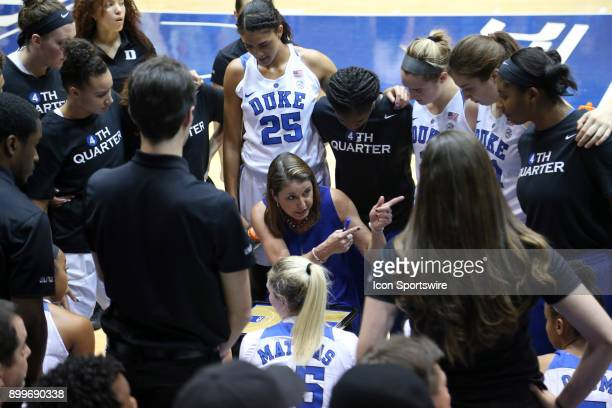 Duke head coach Joanne P McCallie talks to her team during a timeout during the Duke Blue Devils game versus the Ohio State Buckeyes on November 30...