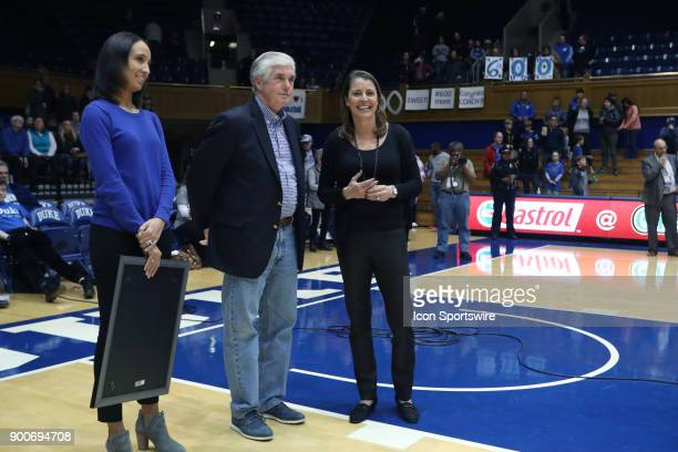 Duke head coach Joanne P. McCallie , with athletic director Kevin White and Deputy Director of Athletics Nina King, is honored after winning her...
