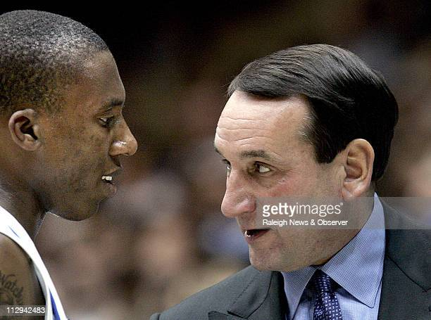 Duke head coach Mike Krzyzewski chats on the sidelines with freshman Nolan Smith during the second half against NCCU at Cameron Indoor Stadium on...