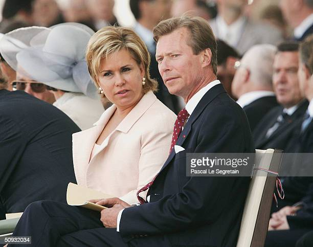 Duke Henri and Duchess Maria Theresa of Luxemburg look on as they attend the commemoration ceremony on the 60th anniversary of DDay on June 6 2004 in...