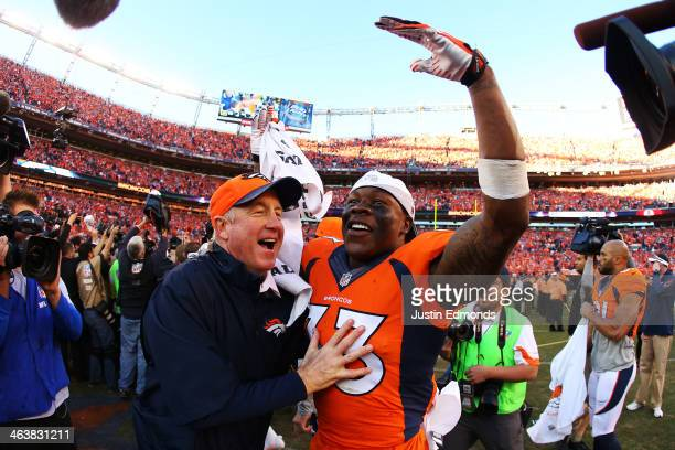 Duke Ihenacho of the Denver Broncos celebrates with head coach John Fox after they defeated the New England Patriots 26 to 16 during the AFC...
