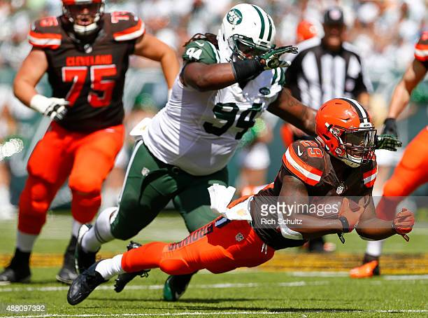 Duke Johnson Jr #29 of the Cleveland Browns dives for extra yards as Damon Harrison of the New York Jets persues during the second quarter of a game...