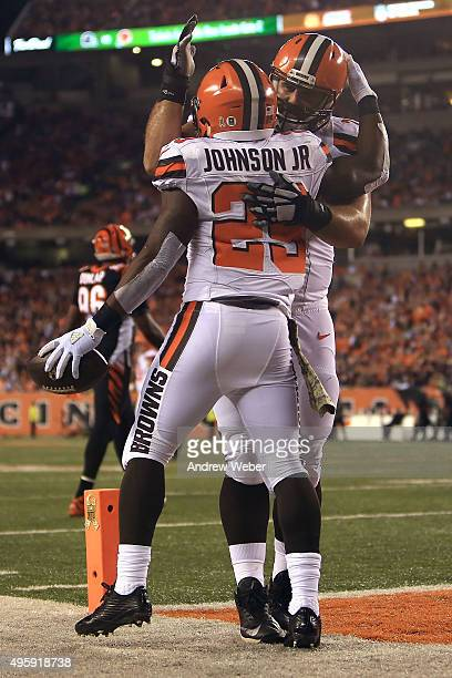 Duke Johnson Jr #29 of the Cleveland Browns is congratulated by John Greco of the Cleveland Browns after scoring a touchdown during the second...