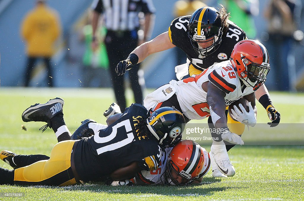 Duke Johnson Jr. #29 of the Cleveland Browns is tackled by Sean Spence #51 and Anthony Chickillo #56 of the Pittsburgh Steelers during the 1st half of the game at Heinz Field on November 15, 2015 in Pittsburgh, Pennsylvania.