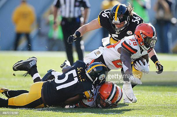 Duke Johnson Jr #29 of the Cleveland Browns is tackled by Sean Spence and Anthony Chickillo of the Pittsburgh Steelers during the 1st half of the...