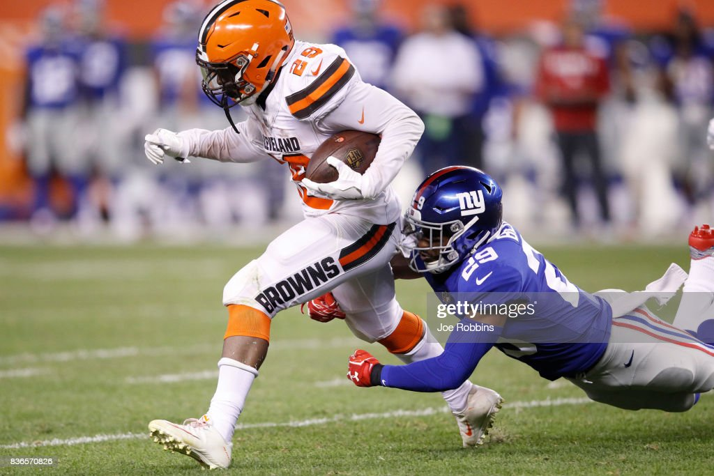 Duke Johnson Jr. #29 of the Cleveland Browns runs the ball against Nat Berhe #29 of the New York Giants in the second half of a preseason game at FirstEnergy Stadium on August 21, 2017 in Cleveland, Ohio.