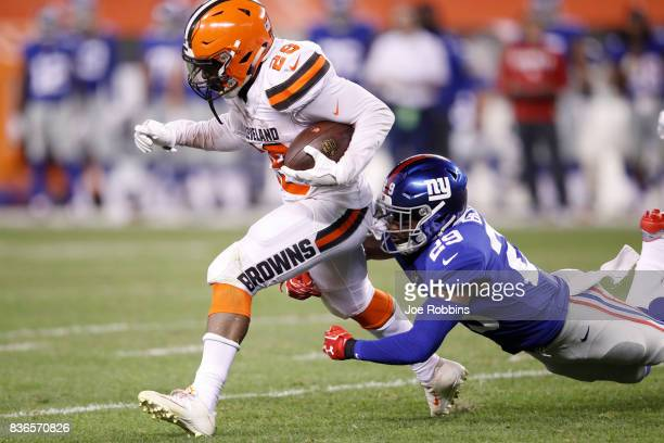 Duke Johnson Jr #29 of the Cleveland Browns runs the ball against Nat Berhe of the New York Giants in the second half of a preseason game at...