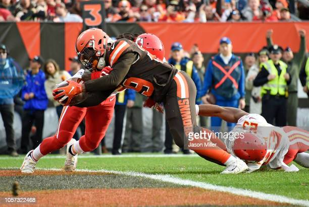 Duke Johnson of the Cleveland Browns dives for a touchdown in front of Kendall Fuller of the Kansas City Chiefs during the fourth quarter at...