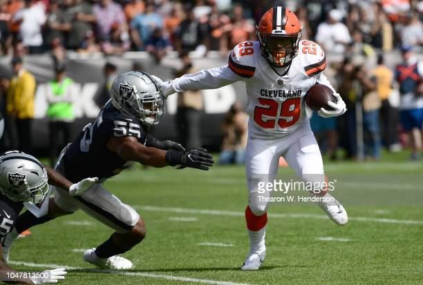 Duke Johnson of the Cleveland Browns fights off the tackle of Marquel Lee of the Oakland Raiders to score a two point conversion during the second...