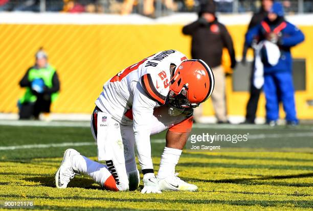 Duke Johnson of the Cleveland Browns kneels in the end zone after 2 yard touchdown run in the second quarter during the game against the Pittsburgh...