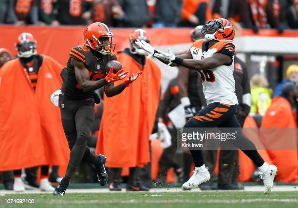 Duke Johnson of the Cleveland Browns makes a catch in front of Hardy Nickerson of the Cincinnati Bengals during the second quarter at FirstEnergy...
