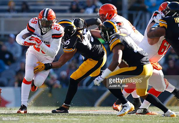 Duke Johnson of the Cleveland Browns rushes against the Pittsburgh Steelers in the first half during the game at Heinz Field on January 1 2017 in...