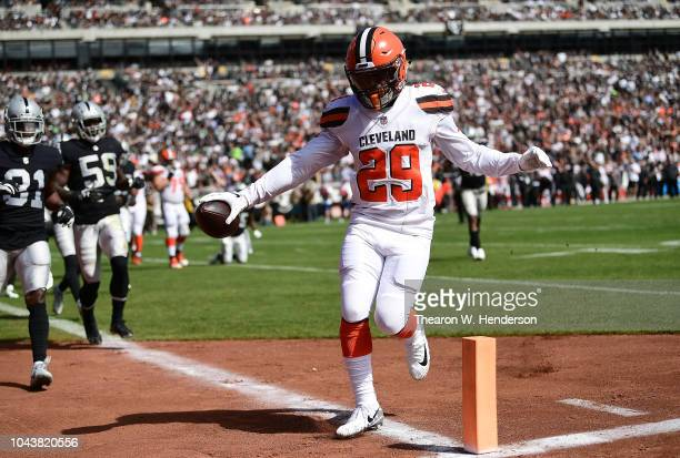 Duke Johnson of the Cleveland Browns scores a two point conversion against the Oakland Raiders during the second quarter of their NFL football game...