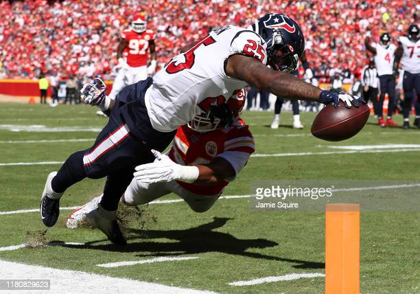 Duke Johnson of the Houston Texans dives for the pylon to score a 11yard receiving touchdown during the second quarter against the Kansas City Chiefs...