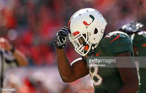 Duke Johnson of the Miami Hurricanes celebrates a touchdown during a game against the North Carolina Tar Heels at Sun Life Stadium on November 1 2014...