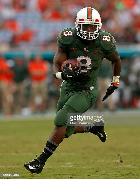 Duke Johnson of the Miami Hurricanes rushes for a touchdown during a game against the Arkansas State Red Wolves at Sunlife Stadium on September 13...
