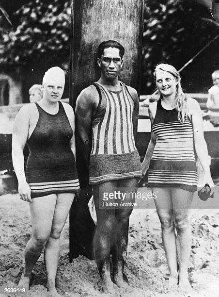 Duke Kahanamoku Hawaiian swimmer and surfer with Charlotte Boyle and Ethelda Bleibtrey practicing on a beach in Waikiki for the 100 yards National...