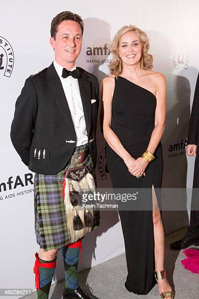 Duke of Argyll Torquil Campbell and actress Sharon Stone attend the inaugural amfAR India event at the Taj Mahal Palace Mumbai on November 17 2013 in...