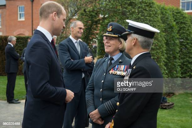 Duke of Cambridge Britain's William talks with Group Captain Teresa Griffiths the Commanding Officer at DMRC Headley Court and Surgeon Commodore...