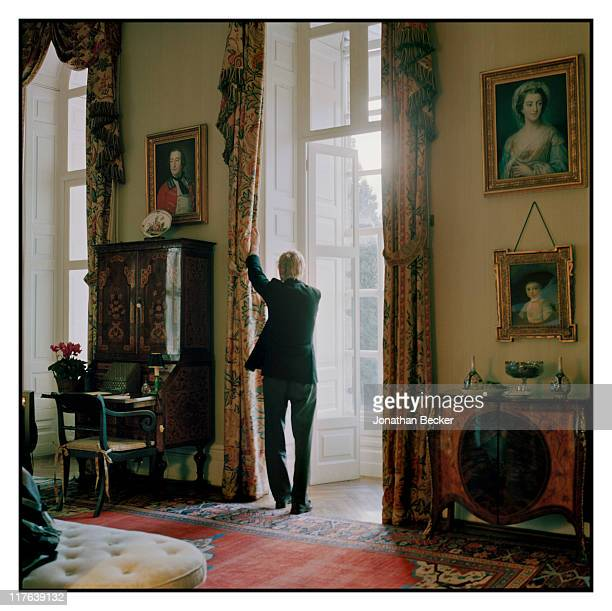 Duke of Marlborough's Blenheim Palace A valet is photographed drawing the curtains in a guest bedroom for Vanity Fair Magazine on October 2527 2010...