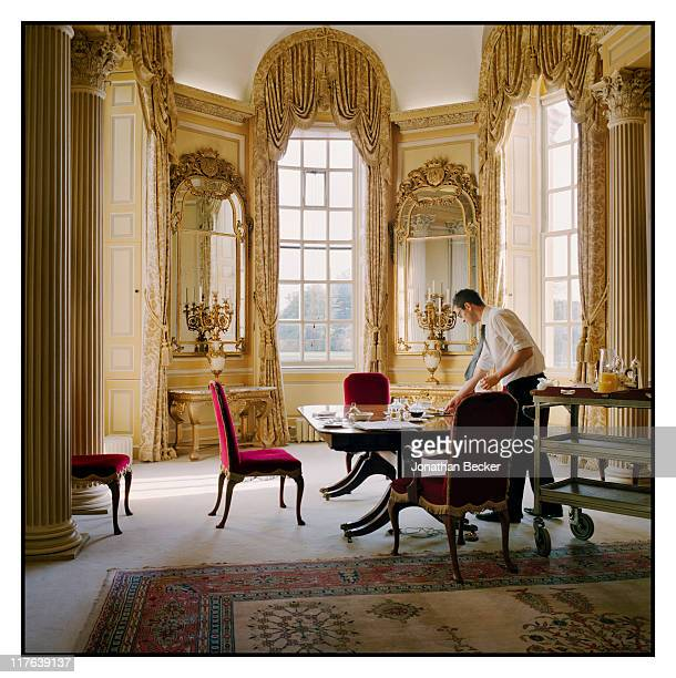 Duke of Marlborough's Blenheim Palace An underbutler is photographed setting the table in the family dining room for Vanity Fair Magazine on October...