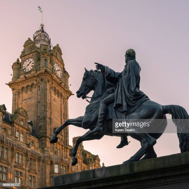 duke of wellington monument with the balmoral clock behind, edinburgh, scotland, united kingdom, europe - balmoral hotel stock pictures, royalty-free photos & images