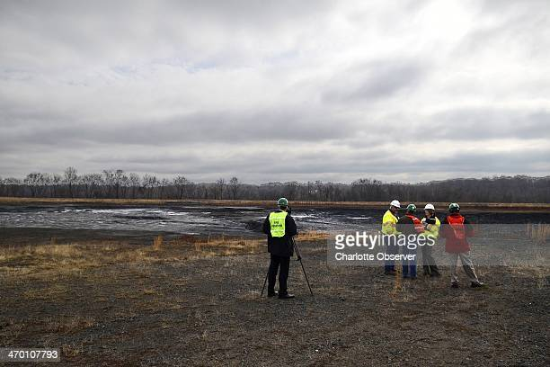 Duke officials took media members on a brief tour of the coal ash pond where an underground storm water pipe developed a break allowing water...
