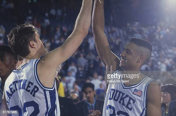 Duke players Grant Hill and Christian Laettner high-five each other in celebration during the NCAA Championship against Kansas in 1991. Duke defeated...