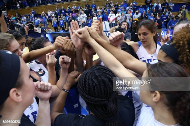 Duke players huddle after the victory during the Duke Blue Devils game versus the Ohio State Buckeyes on November 30 at Cameron Indoor Stadium in...