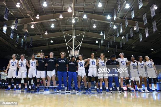 Duke players join in the alma mater after the win during the Duke Blue Devils game versus the Ohio State Buckeyes on November 30 at Cameron Indoor...
