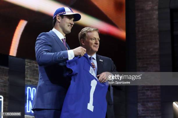 Duke quarterback Daniel Jones poses with NFL Commissioner Roger Goodell after being selected by the New York Giants during the first round of the...