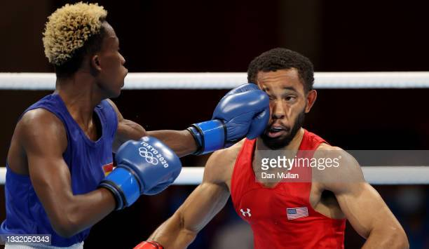 Duke Ragan of Team United States exchanges punches with Samuel Takyi of Team Ghana during the Men's Feather semi final on day eleven of the Tokyo...