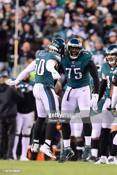 Duke Riley and Vinny Curry of the Philadelphia Eagles celebrate the play against the Seattle Seahawks in the NFC Wild Card Playoff game at Lincoln...