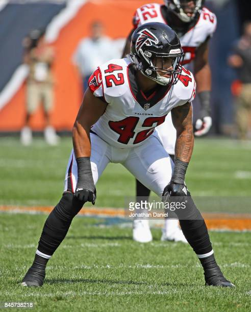 Duke Riley of the Atlanta Falcons awaits the snap against the Chicago Bears during the season opening game at Soldier Field on September 10 2017 in...