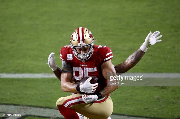 Duke Riley of the Philadelphia Eagles tackles George Kittle of the San Francisco 49ers after a touchdown during the third quarter in the game at...