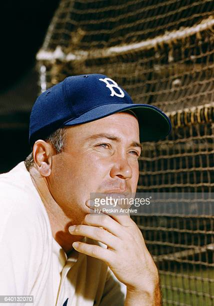Duke Snider of the Brooklyn Dodgers poses for a portrait next to the batting cage before a Spring Training game against the Boston Red Sox circa...