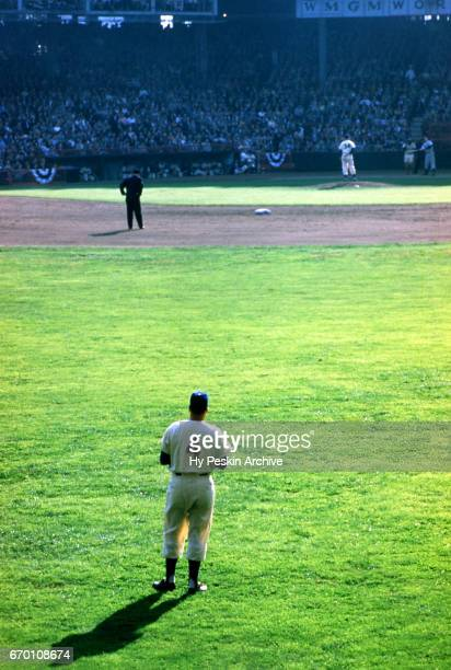Duke Snider of the Brooklyn Dodgers looks in from centerfield as pitcher Russ Meyer of the Dodgers looks in to get the sign during a 1955 World...