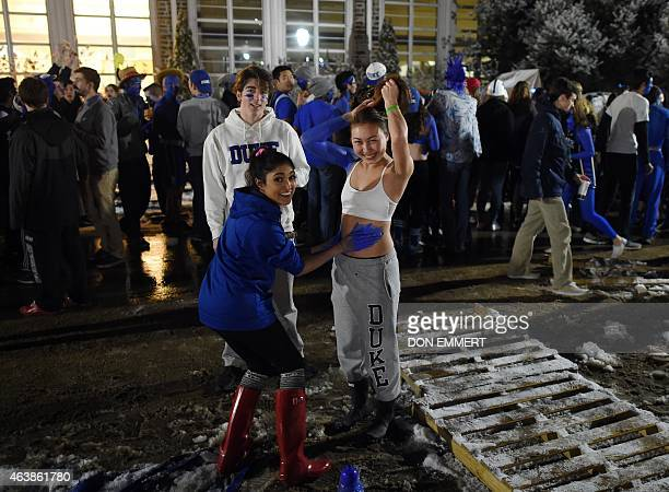 Duke students get face and body paint in KVille named after Duke head coach Mike Krzyzewski as they prepare for the big game February 18 2015 at Duke...