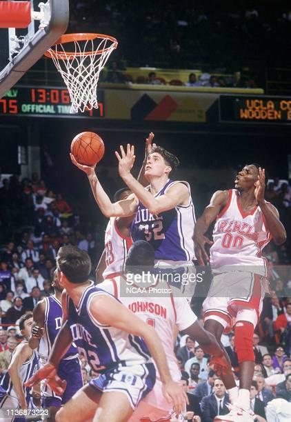 Duke University forward Christian Laettner finds himself surrounded by UNLV defenders on his way to the basket during the NCAA Photos via Getty...