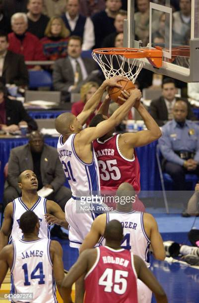 Duke University forward Shane Battier goes over University of Maryland forwardcenter Lonny Baxter to win a jump ball call during the Division 1...