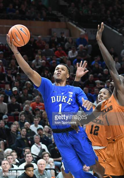 Duke University guard Trevon Duval attempts an offbalance shot in a college basketball game during the PK80Phil Knight Invitational between the Duke...
