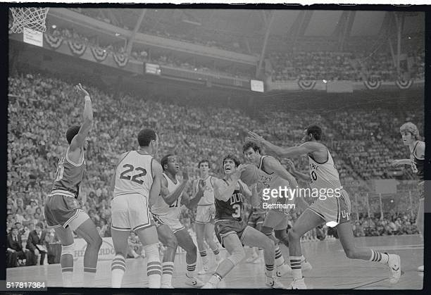 Duke University's Jim Spanarkel has no place to go as he is surrounded by Kentucky's Truman Clayton, Jack Givens, Kyle Macy, Mike Phillips and Fred...