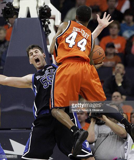 Duke's Brian Zoubek fouls Virginia's Sean Singletary on Singletary's drive to the basket during second half action The Blue Devils defeated the...